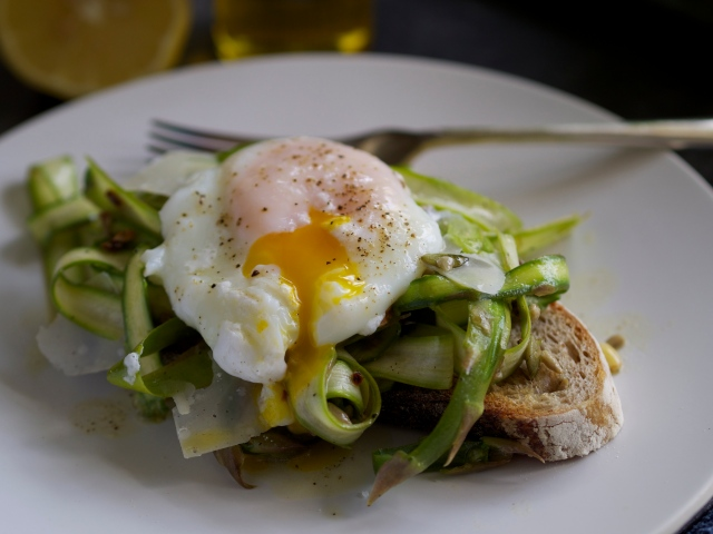 Shaved asparagus bruschetta with poached egg