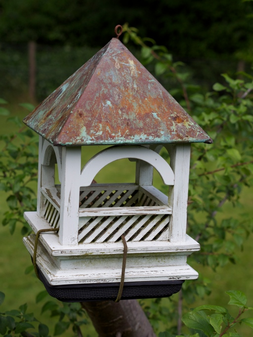 A little bird house in the orchard