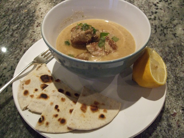 Lamb curry served with a squeeze of  lemon and warm naan bread